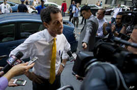 Former congressman Anthony Weiner, at the time a New York City mayoral candidate, is seen speaking to members of the media in New York, July 24, 2013. In a twist, the contents of his computer might now well determine who will next occupy the White Ho