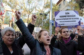 Turkish women stage a protest in Ankara, Nov. 19, 2016, against a proposed law that would defer sentencing or punishment for child sexual assault in cases where there was no force and where the victim and perpetrator were later married. The placard r