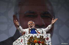 India's Prime Minister Narendra Modi addresses a rally in Srinagar, Nov. 7, 2015. Modi pledged $12.10 billion in funds to bolster development and economic growth in Kashmir, a year after the worst flooding in more than a century destroyed half a mill