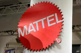 FILE - The Mattel logo at the TTPM 2018 Spring Showcase in New York, April 26, 2018. Mattel says it will cut 2,200 jobs as the maker of Barbie dolls and Hot Wheels cars tries to save money.