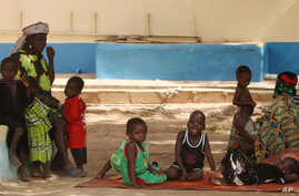 Children suffering from lead poisoning wait to see medical workers, in Gusau, Nigeria, Jun. 9, 2010.