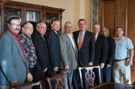 U.S. Senators Tim Kaine and Mark Warner, Democrats from Virginia, pose with seven Virginia tribal chiefs ahead of final passage of bill granting recognition to six Virginia Indian tribes, January 11, 2017.  President Donald Trump signed the new law J