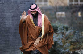 FILE - Saudi Arabia's Crown Prince Mohammed bin Salman waves as he arrives for talks at 10 Downing Street, in central London, Britain, March 7, 2018. In a U.S. television interview, Prince Mohammed likened Iran's Supreme Leader Ali Khamenei to Adolf