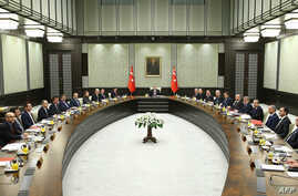A handout made available by the Presidential Palace Press Office on January 19, 2015 shows Turkey's President Recep Tayyip Erdogan (Rear) presiding over the cabinet meeting at the presidential palace in Ankara, Jan. 19, 2015.
