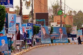 Campaign posters for Iraqi Sunni political blocks line a street in the predominately Sunni neighborhood of Azamiya, in north Baghdad, Iraq, May 8, 2018.