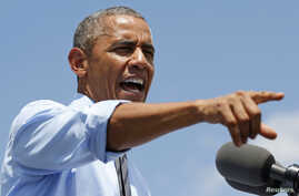 U.S. President Barack Obama speaks during a visit to the Port of Wilmington in Wilmington, Delaware about the economy and the Malaysian airliner brought down over eastern Ukraine Thursday, killing all 295 people aboard, July 17, 2014.