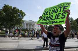 Carlos Guzman of Albany, Ga., holds a sign during an immigration reform rally in front of the White House, Washington, July 24, 2013.