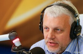 FILE - Journalist Pavel Sheremet talks on the air at a radio station in Kyiv, Ukraine, Oct. 11, 2015.