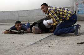 Egyptian security forces help the lifeless body of Giza Police Chief Gen. Nabil Farag, center, who was killed after unidentified militants opened fire on security forces in Kerdasah, Sept. 19, 2013.