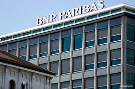 A Sign for the French bank,  BNP Paribas, is pictured on its building in Geneva, Switzerland, July 1, 2014.