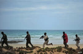 Somali security forces patrol along the coast of Qaw, in Puntland, northeastern Somalia, Dec. 18, 2016.
