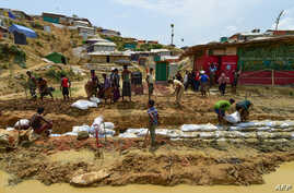 Rohingya refugees make a drainage canal in preparation for the upcoming monsoon season in Kutupalong refugee camp in Ukhia, Bangladesh, May 8, 2018.