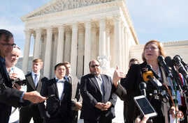FILE - Samsung's counsel of record Kathleen M. Sullivan (R)  answers questions from the media outside the U.S. Supreme Court following oral arguments on Oct. 11, 2016 in Washington in this photo distributed by Samsung.