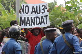 A protester holds a placard as they demonstrate against the ruling CNDD-FDD party's decision to allow Burundi President Pierre Nkurunziza to run for a third five-year term in office, in Bujumbura, May 4, 2015.