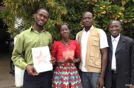 Maseray Kamara, flanked by her fellow burial team members in Freetown, holds the the Bond International Humanitarian Award, given to burial teams from across Sierra Leone for their contributions to stopping the spread of the Ebola virus, June 5, 2015
