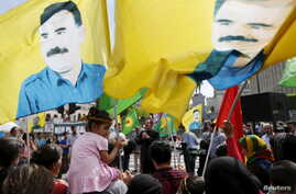 Protesters wave flags with the picture of Kurdistan Workers Party (PKK)'s jailed leader Abdullah Ocalan during a demonstration against the Turkish army operations on Kurdish militants, in central Brussels, Belgium, Aug. 8, 2015.