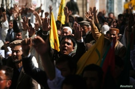 Shi'ite Muslims shout slogans during a protest against the bomb attack in Karachi, in Quetta, Pakistan March 4, 2013.