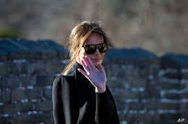 U.S. first lady Melania Trump reacts to photographers as she walks along the Mutianyu Great Wall section in Beijing, China, Nov. 10, 2017.