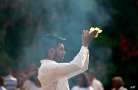 A Sri Lankan Buddhist devotee offers prayers in a temple to mark the Poson full moon day, in Kelaniya, on the out skirts of Colombo, Sri Lanka, June 8, 2017.