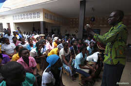 FILE - Youths attend a talk on sexual and domestic violence and HIV/AIDS prevention in Agoe-Nyive, a suburb of Lome.