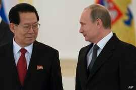 "FILE -  North Korea's ambassador to Russia, Kim Hyun Joon, pictured with Russian President Vladimir Putin in November 2014, says ""it is well-known that the DPRK is already a nuclear state in both content and form."""