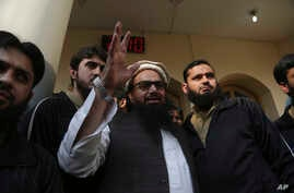 Hafiz Saeed, head of the Pakistan's Jamaat-ud-Dawa group waves to supporters at a mosque in Lahore, Pakistan, Nov. 24, 2017.