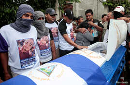 Demonstrators take part in funeral services of Agustin Ezequiel Mendoza, who was shot in recent protests against Nicaraguan President Daniel Ortega's government in Tipitapa, Nicaragua, June 15, 2018.