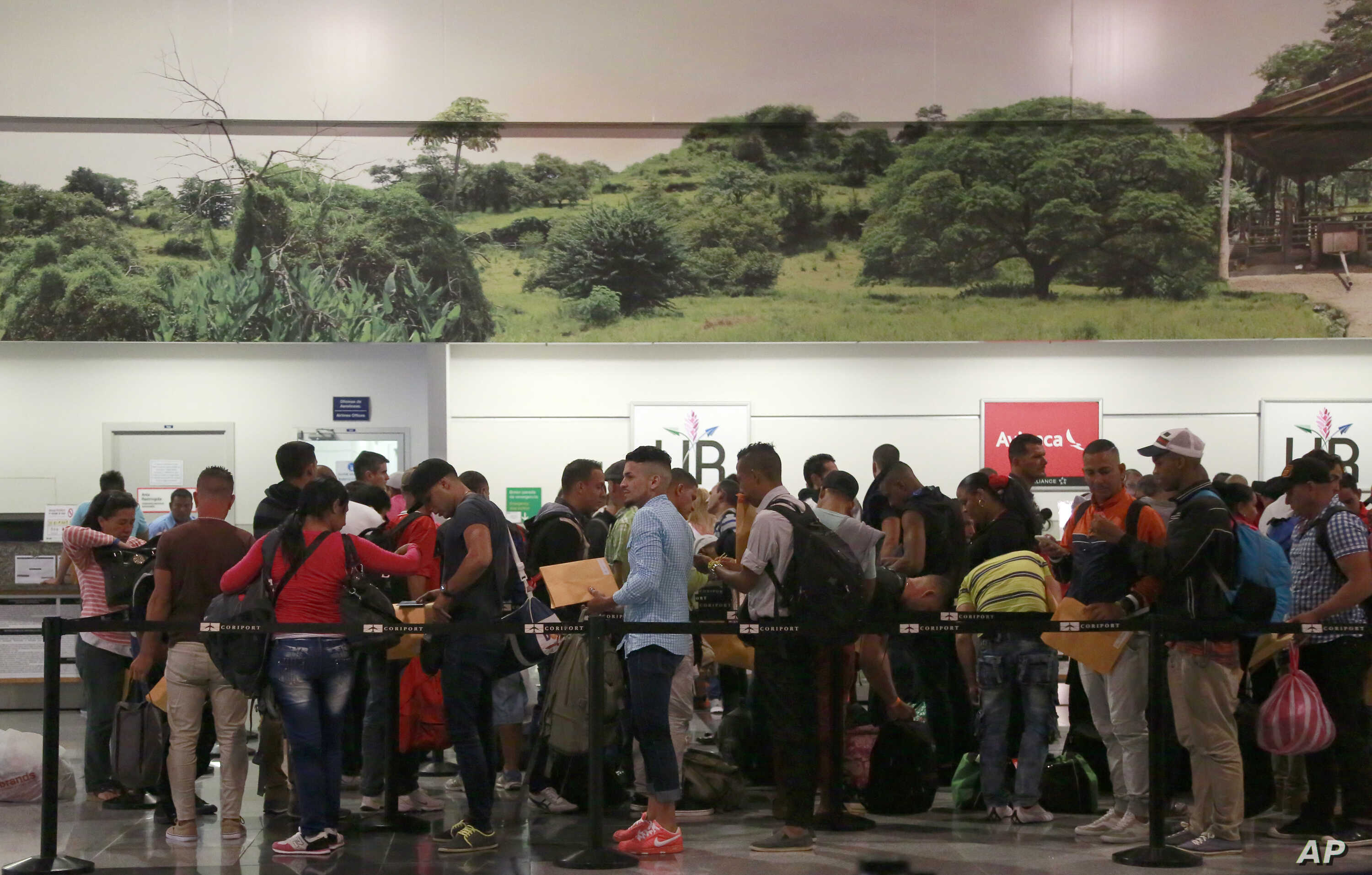 Cuban migrants wait to check-in at the Daniel Oduber Quiros International Airport in Liberia, Costa Rica, Jan. 12, 2016.