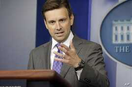 White House deputy press secretary Josh Earnest speaks during his daily news briefing at the White House in Washington, Wednesday, Aug., 21, 2013.