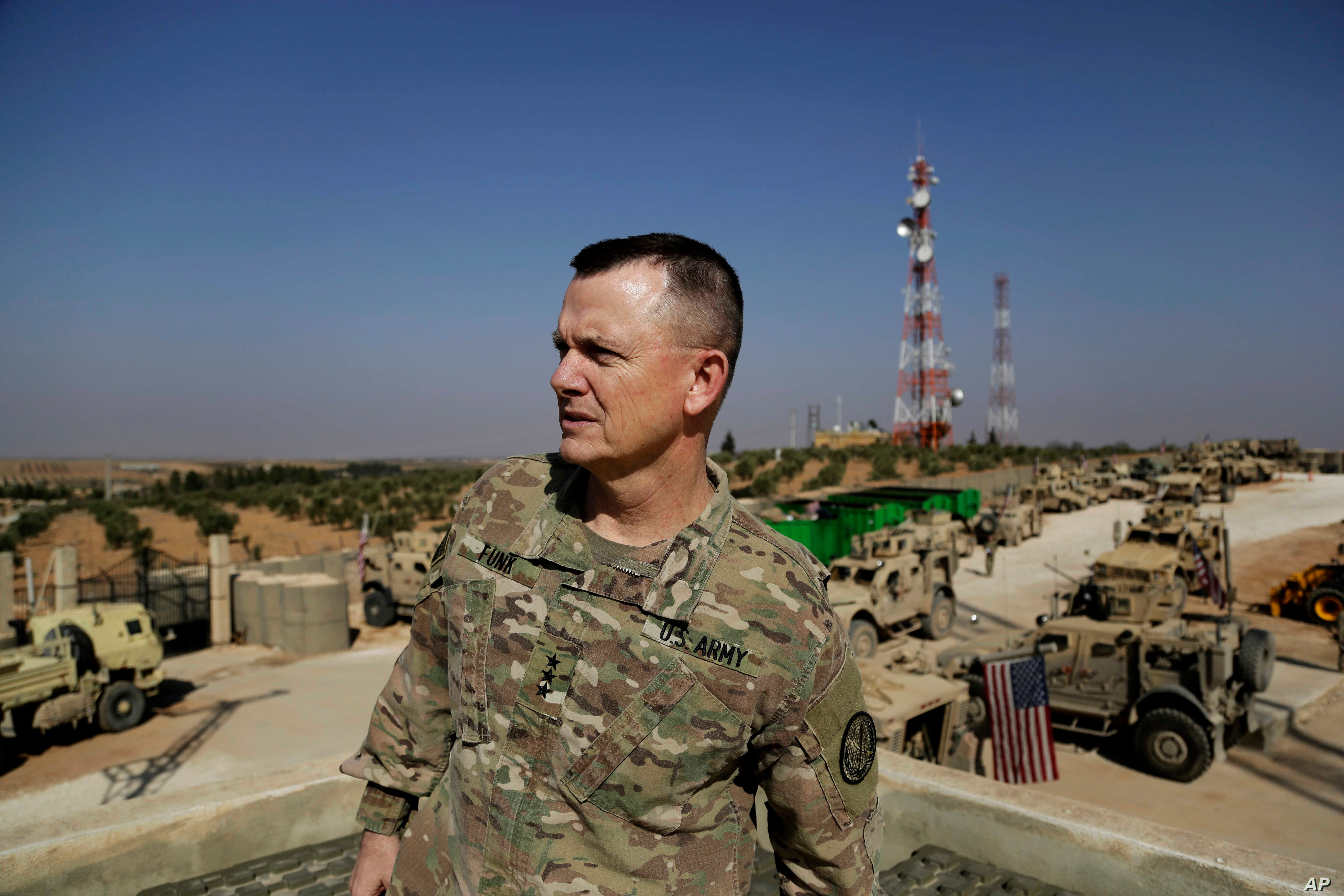 U.S. Army Lt. Gen. Paul E. Funk speaks to the Associated Press at an American outpost in the northern Kurdish town of Manbij, Syria, Feb. 7, 2018. The top U.S. general in the coalition fighting the Islamic State group pledged American troops would re...