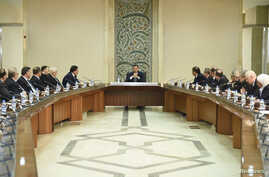 Syria's President Bashar al-Assad heads a meeting of his new cabinet in Damascus, Aug. 31, 2014