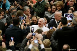 Pope Francis arrives to lead the weekly audience in Paul VI's hall at the Vatican, Jan. 20, 2016.