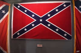 Confederate flags that once flew at the South Carolina Statehouse are displayed at the South Carolina State Museum, June 24, 2015, in Columbia, S.C.