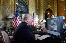 President Donald Trump speaks with members of the armed forces via video conference at his private club, Mar-a-Lago, on Thanksgiving, Nov. 23, 2017, in Palm Beach, Fla.