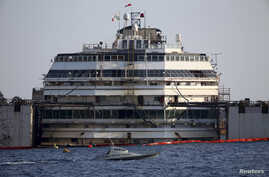 The cruise liner Costa Concordia is seen during a refloat operation at Giglio harbour at Giglio Island, Italy, July 14, 2014.