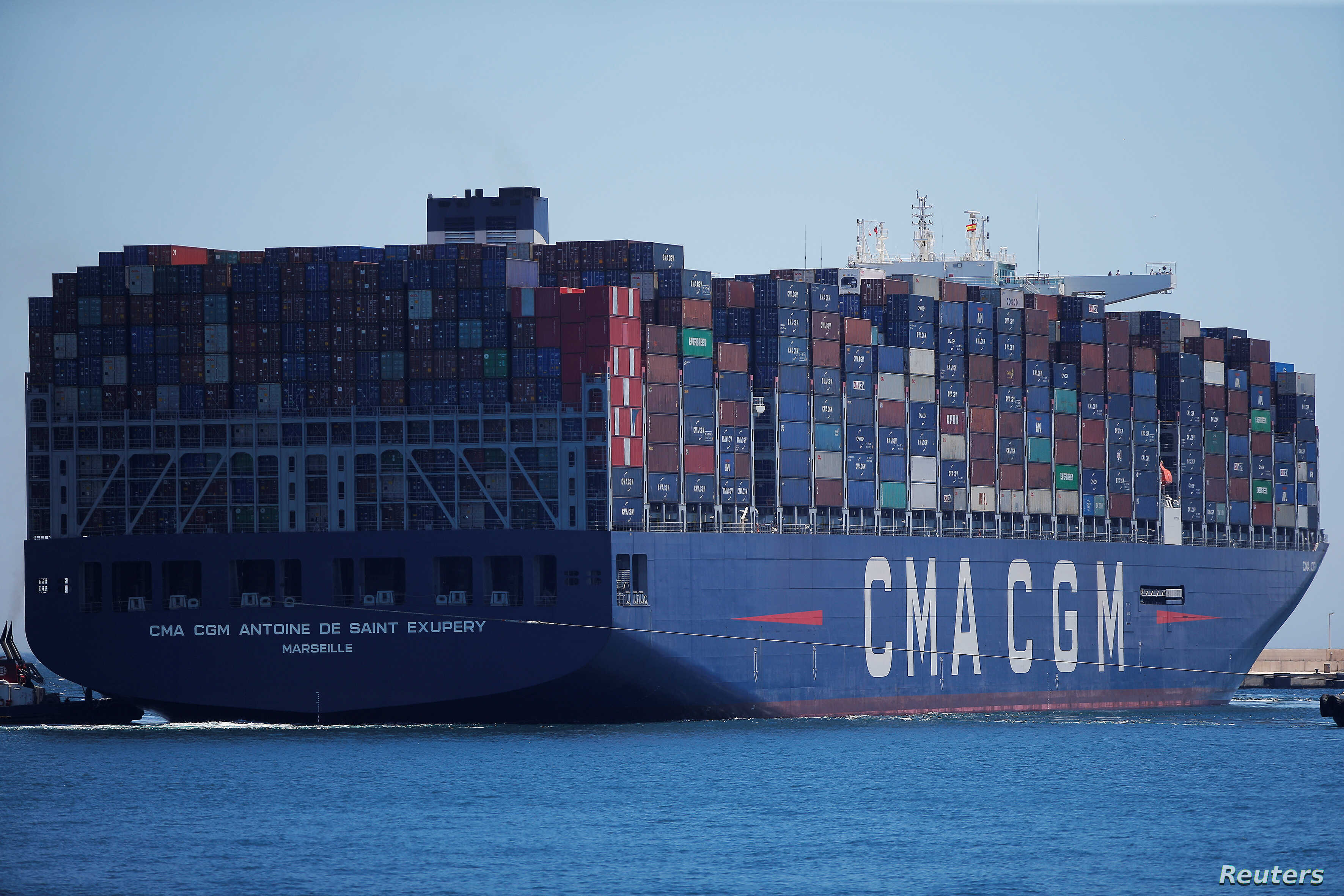FILE - Containers are pictured on the Antoine de Saint Exupery, a cargo ship of French shipping company CMA CGM after leaving the port of Algeciras, Spain, May 31, 2018. CMA CGM  said July 7, 2018, that it was pulling out of Iran for fear of becoming