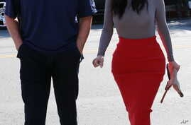 FILE - Kim Kardashian and Bruce Jenner are spotted heading back to their cars after having lunch in West Hollywood, California, October 21, 2014.