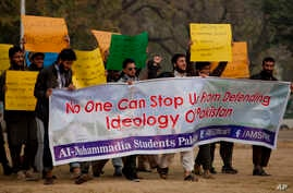 Pakistani students affiliated with a Pakistani religious party shout anti-American slogans at a rally in Islamabad, Pakistan, Dec. 30, 2016.