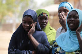 FILE - Boko Haram attacks on the Nigerian town of Gulak forced these women to flee to a refugee camp in September. The African Union is finalizing a plan for a 7,500-strong regional force to fight the Islamic extremist group.