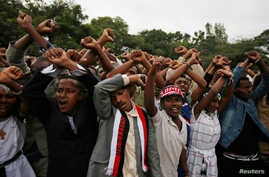 Demonstrators protest gesture during Irreecha, the thanksgiving festival of the Oromo people, in Bishoftu town, Oromia region, Ethiopia. More than 50 people were killed in the violence.