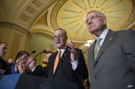 FILE - Sen. Chuck Schumer, D-N.Y., center, flanked by Senate Minority Leader Harry Reid, D-Nev., right, and Sen. Patty Murray, D-Wash., left, speaks with reporters just before Democrats blocked legislation from the GOP-led House on a bill that would