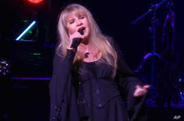 "This image made from video shows singer Stevie Nicks singing ""Rhiannon"" during a surprise performance after the curtain call for the musical  ""School of Rock,"" April 26, 2016, in New York."