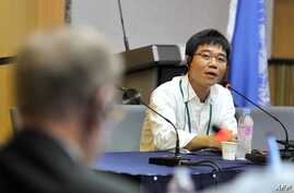 FILE - Ji Seong-ho, a North Korean defector, speaks as Michael Kirby, left, chairman of the U.N. Commission of Inquiry on Human Rights in North Korea, listens during a public hearing at Yonsei University in Seoul, Aug. 22, 2013.