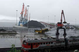 FILE - Coal brought from Siberia can be seen awaiting loading onto a ship bound for China in the North Korean special economic zone of Rason.