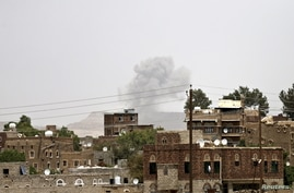 Smoke rises from a military post after it was hit by an air strike in Sana'a, April 11, 2015.