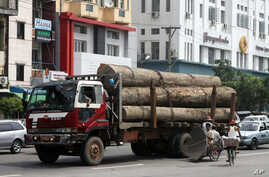 A truck loaded with teak logs runs on a road in Rangoon, Burma. U.S. Secretary of State announced the US will ease its import ban on Burma, Sept. 27, 2012.