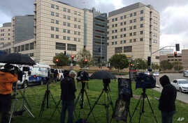 A large gathering of media personnel camp outside the Ronald Reagan UCLA Medical Center in Los Angeles, Dec. 23, 2016, where TMZ and the Los Angeles Times reported actress Carrie Fisher had been taken after suffering a medical emergency on a flight f
