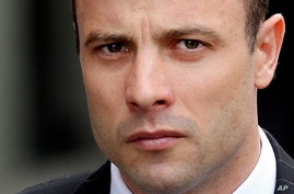 Oscar Pistorius arrives at the high court in Pretoria, South Africa, April 9, 2014.
