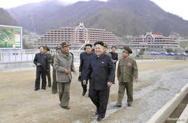 North Korean leader Kim Jong Un (front) visits the construction site of a ski resort on Masik Pass, in this undated photo released by North Korea's Korean Central News Agency (KCNA) in Pyongyang on Nov. 3, 2013.
