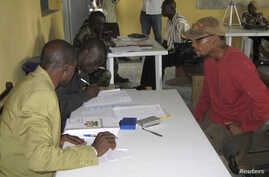 FILE - Nigerian security personnel register a former militant at an arms collection center in Ogoloma-Okrika district, east of Port Harcourt, Aug. 20, 2009. Paul Boroh, head of the amnesty program, was fired March 13, 2018, amid graft allegations.